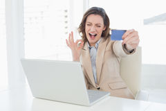 Businesswoman doing online shopping in office Royalty Free Stock Image