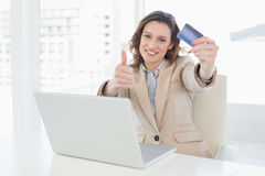 Businesswoman doing online shopping in office Royalty Free Stock Photos