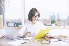 Businesswoman doing paperwork Stock Image