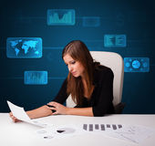 Businesswoman doing paperwork with digital background. Businesswoman doing paperwork with futuristic digital backgroung Royalty Free Stock Photo