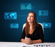 Businesswoman doing paperwork with digital background Stock Image