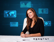 Businesswoman doing paperwork with digital background Royalty Free Stock Images