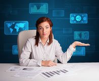 Businesswoman doing paperwork with digital background Stock Images