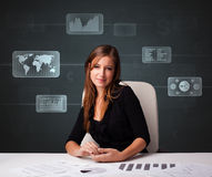 Businesswoman doing paperwork with digital background Royalty Free Stock Photography