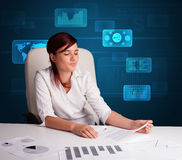 Businesswoman doing paperwork with digital background Stock Photo