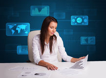 Businesswoman doing paperwork with digital background Stock Photography