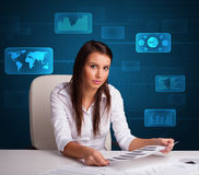 Businesswoman doing paperwork with digital background Royalty Free Stock Photos