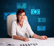 Businesswoman doing paperwork with digital background Royalty Free Stock Photo