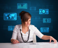 Businesswoman doing paperwork with digital background Stock Photos