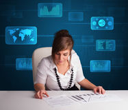 Businesswoman doing paperwork with digital background Royalty Free Stock Image