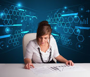 Businesswoman doing paperwork with futuristic background Royalty Free Stock Photo
