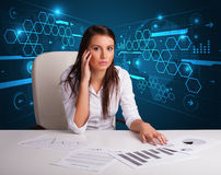 Businesswoman doing paperwork with futuristic background Stock Photography
