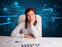 Businesswoman doing paperwork with futuristic background Royalty Free Stock Photography