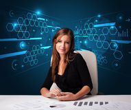Businesswoman doing paperwork with futuristic background Stock Images