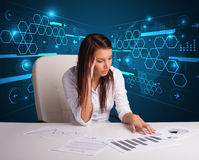 Businesswoman doing paperwork with futuristic background Stock Photo