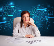 Businesswoman doing paperwork with futuristic background Stock Photos