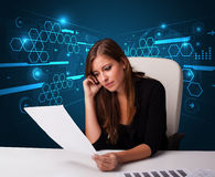Businesswoman doing paperwork with futuristic background Royalty Free Stock Image