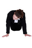 Businesswoman doing push-ups Royalty Free Stock Photo