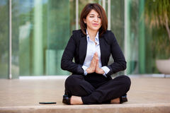 Businesswoman doing some yoga Royalty Free Stock Images