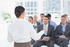 Businesswoman doing speech during meeting Stock Image