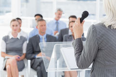 Businesswoman doing speech during meeting Stock Images