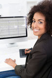 Businesswoman doing a spreadsheet Stock Image