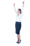 Businesswoman doing a victory pose Stock Photography