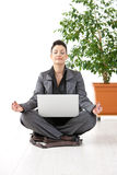 Businesswoman doing yoga Stock Photo