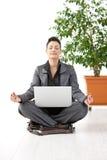 Businesswoman Doing Yoga Stock Photo