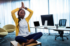 Businesswoman doing yoga. At the office Royalty Free Stock Image