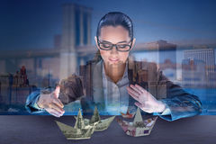 The businesswoman with dollar boats in business concept Royalty Free Stock Images