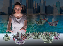 The businesswoman with dollar boats in business concept Stock Photography