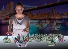 The businesswoman with dollar boats in business concept Stock Photos