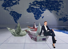 The businesswoman with dollar boats in business concept Royalty Free Stock Photo