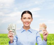 Businesswoman with dollar cash money Stock Images