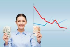 Businesswoman with dollar and euro cash money Stock Photo