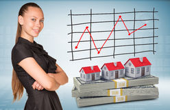 Businesswoman and dollar packs with row houses Stock Image