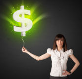 Businesswoman with a dollar sign balloon. Businesswoman holding a shining, green dollar sign balloon Stock Photos