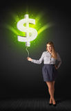 Businesswoman with a dollar sign balloon Royalty Free Stock Photography