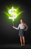 Businesswoman with a dollar sign balloon Stock Photography