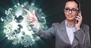 The businesswoman with dollars talking on mobile phone Royalty Free Stock Images