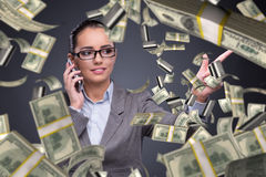 The businesswoman with dollars talking on mobile phone Stock Photography