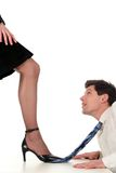 Businesswoman dominating businessman. Over white background royalty free stock photos