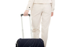 Businesswoman dragging suitcase. Stock Images