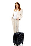 Businesswoman dragging suitcase. Royalty Free Stock Images