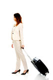 Businesswoman dragging suitcase. Stock Photo