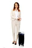 Businesswoman dragging suitcase. Royalty Free Stock Photography