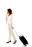 Businesswoman dragging suitcase. Royalty Free Stock Photos