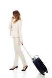 Businesswoman dragging suitcase. Stock Image
