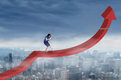 Businesswoman drags arrow upward Stock Photography